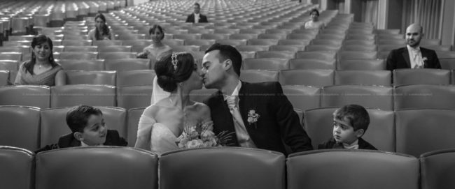 Bride and groom kissing during a post wedding shoot at the Aurora theater in Victoria, Gozo